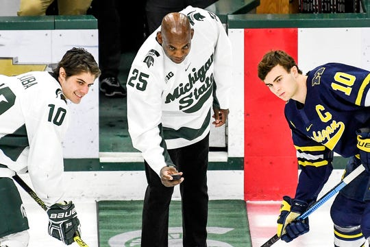 Michigan State's head football coach Mel Tucker, center, prepares to drop the puck before the Spartans game against Michigan on Friday, Feb. 14, 2020, at the Munn Ice Arena in East Lansing. At left, MSU's Sam Saliba and Will Lockwood look on.