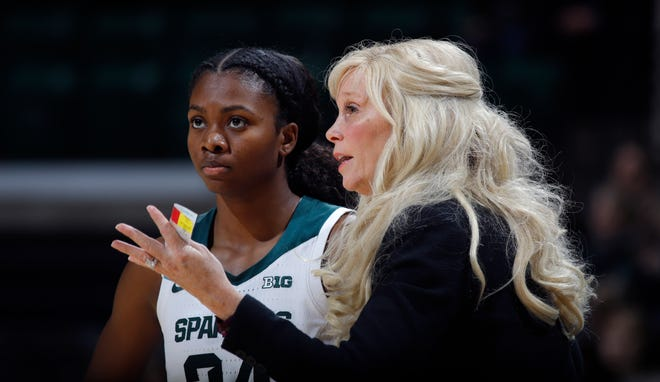 Michigan State coach Suzy Merchant talks with Nia Clouden against Rutgers, Thursday, Feb. 13, 2020, in East Lansing, Mich.