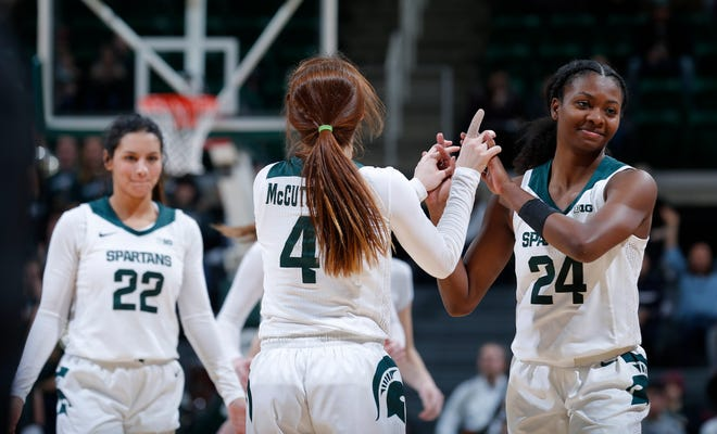 Michigan State's Taryn McCutcheon, center, is congratulated by Nia Clouden, right, as Moira Joiner, left, smiles after McCutcheon sank free throws to ice the game against Rutgers, Thursday, Feb. 13, 2020, in East Lansing, Mich.