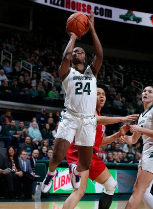 Michigan State's Nia Clouden (24) puts up a driving shot against Rutgers, Thursday, Feb. 13, 2020, in East Lansing, Mich.