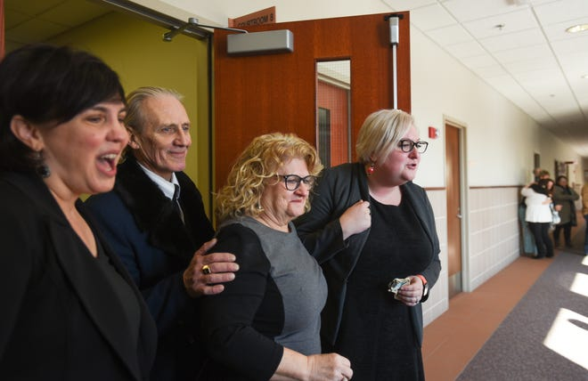 Flanked by members of her legal defense team, former MSU gymnastics coach Kathie Klages and husband Ross Klages leave Judge Joyce Draganchuk's courtroom during a recess Friday, Feb. 2020, after Klages gave testimony in the trial where she faces two counts of lying to police.  Attorney Mary Chartier is pictured on left, and paralegal Lizzy Cary on the right.