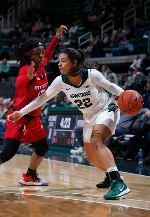 Michigan State's Moira Joiner, right, drives against Rutgers' Khadaizha Sanders, Thursday, Feb. 13, 2020, in East Lansing, Mich.