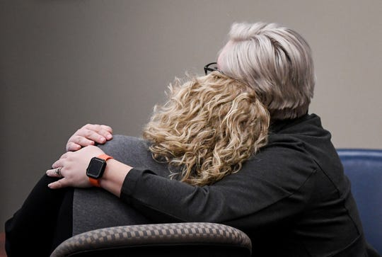 Lizzy Cary, right, a member of former Michigan State University women's gymnastics coach Kathie Klages' legal team comforts Klages after a jury found Klages guilty of both charges of lying to police, Friday, Feb. 14, 2020, in Ingham County Court.