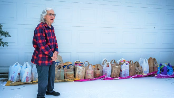 Marilyn Mather, who is 88, braves the roads twice a month to donate food to those in need.