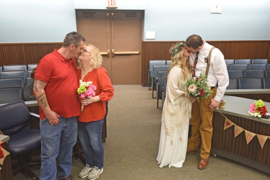 Couples Jeremy Adams and Cynthia Myers and Christopher Rogers and Lindsey Adams were married on Valentine's Day by Judge Frank Ardis Jr.
