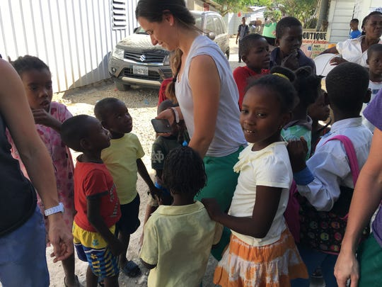 Haitian children await medical treatment during a previous medial mission trip to the country.