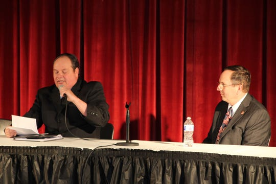 Crawford County Commissioner Doug Weisenauer, right, listens as challenger Jeffrey Price reads his opening statement during a Republican Party candidates forum on Thursday at Bucyrus High School.