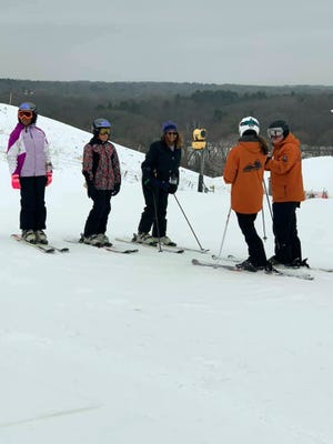 Skiers take a lesson with instructors at The Rock during a Learn to Ski event hosted by the Ebony Ice Ski Club on Feb. 1, 2020.