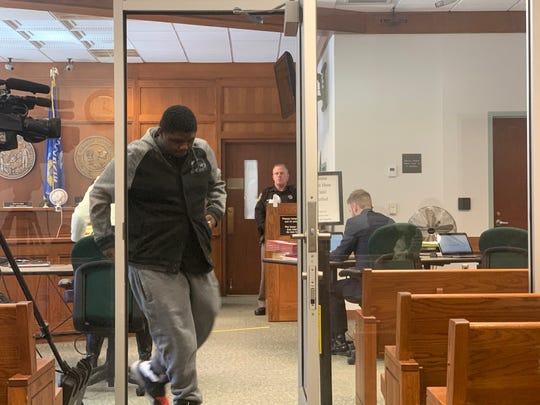 Tyrone Smith, the 18-year-old Waukesha South High School student charged with felony reckless endangerment for a Dec. 2, 2019, gun incident at the school, emerges from the courtroom at the Waukesha County Courthouse on Feb. 14, 2020. The court declined to dismiss the felony charge during a preliminary hearing.