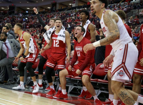 Wisconsin players celebrate as time winds down in an upset victory at Ohio State.