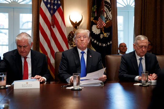 Secretary of State Rex Tillerson, left, and Secretary of Defense Jim Mattis, right, listen as President Donald Trump speaks during a cabinet meeting at the White House, Wednesday, Dec. 20, 2017, in Washington. (AP Photo/Evan Vucci) ORG XMIT: DCEV109