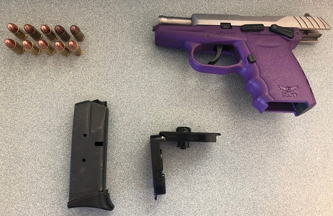 A Milwaukee woman was caught by airport security with this 9mm handgun, which was loaded with 10 bullets, in her carry-on bag Thursday.