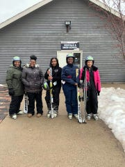 Women with the Ebony Ice Ski Club are ready to ski at The Rock in Franklin during the club's Learn to Ski event on Feb. 1, 2020.