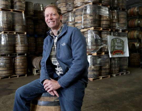John Gill is called The Barrel Broker. He buys barrels from distilleries and wineries and sells them to breweries and other businesses. Part of the job is keeping up with a Menomonee Falls warehouse filled with empty barrels.