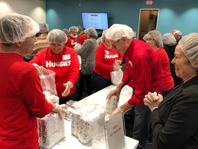 Gov. Tony Evers helps package some of the diapers Kimberly-Clark donated Thursday for Milwaukee families throughthe United Way of Greater Milwaukee & Waukesha County and National Diaper Bank Network. Kimberly-Clark, the maker of Huggies, donated 25,000 diapers.