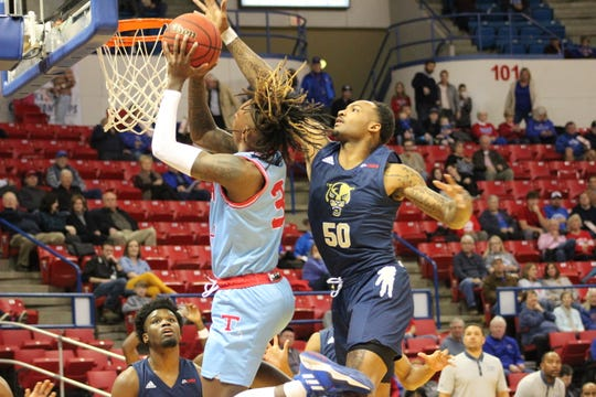 Louisiana Tech junior guard Amorie Archibald (3) puts up a shot against FIU's Devon Andrews (50) Thursday night at the Thomas Assembly Center.