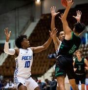 Lanier's Elijah White (10) and Malik Stinson (3) defend against Pelham's Roy Gonzalez (5) during AHSAA regional basketball action in Montgomery, Ala., on Friday February 14, 2020.