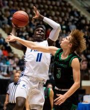 Lanier's Antwan Burnett (11) shoots against Pelham's Nate Rottier (3) during AHSAA regional basketball action in Montgomery, Ala., on Friday February 14, 2020.
