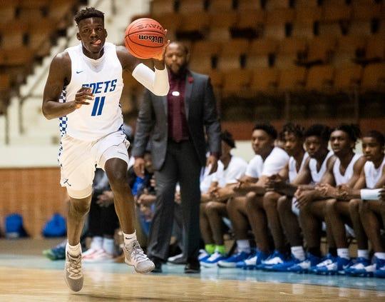 Lanier's Antwan Burnett (11) gets a steal against Pelham during AHSAA regional basketball action in Montgomery, Ala., on Friday February 14, 2020.