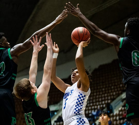 Lanier's Greedy Williams (5) shoots against Pelham during AHSAA regional basketball action in Montgomery, Ala., on Friday February 14, 2020.