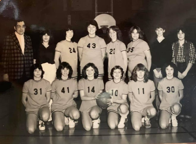 A picture of Daleville's 1979-80 girls basketball team. John Craig (left) and his daughters Bev Craig (No. 24) and Diane Craig (far right) are among those pictured.