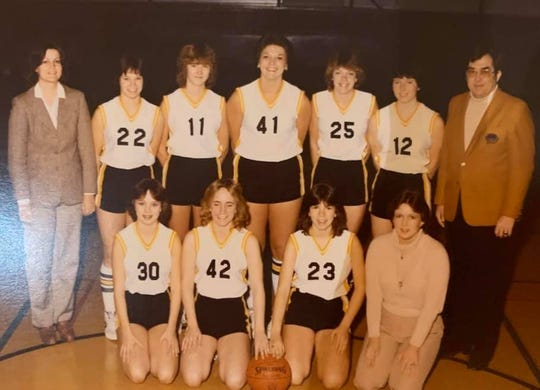 A picture of Daleville's 1980-81 girls basketball team. John Craig (far right) and his daughters Bev Craig (No. 12) and Diane Craig (front row, far right) are among those pictured.