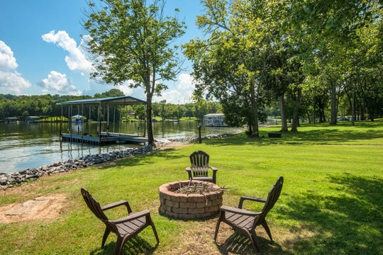 The home at 106 S. Governors Cove in Hendersonville, listed for $1.59 million, has 3 bedrooms, 4.5 baths,  three fireplaces, an in-ground pool and a private dock on the lake.