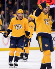 Nashville Predators right wing Craig Smith (15) reacts after defeating the New York Islanders at Bridgestone Arena in Nashville on Thursday.