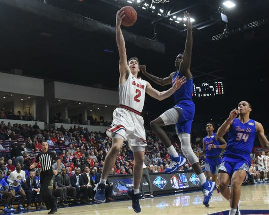 Belmont's Grayson Murphy (2) drives for a layup in the Bruins' win over Tennessee State Thursday night at Curb Event Center.