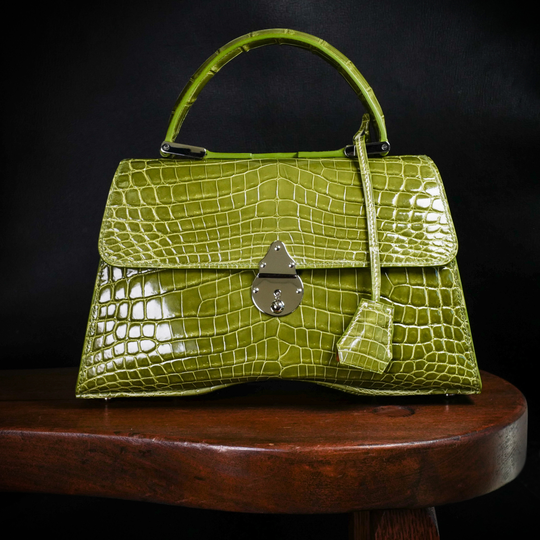 A lime green alligator handbag by Chester Mox. In January, Chester Mox turned away more than $50,000 in orders for alligator skin products after California passed a law outlawing the importation of alligator skins.
