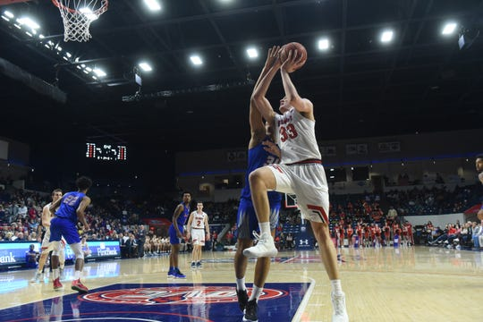 Nick Muszynski drives for a layup in Belmont' win over Tennessee State Saturday night at Curb Event Center.