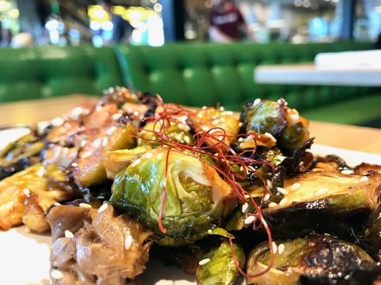 Roast Brussels sprouts ($9), with mushroom, miso sesame vinaigrette and a chili thread, a seasonal appetizer at True Food Kitchen in Waterside Shops, Naples.