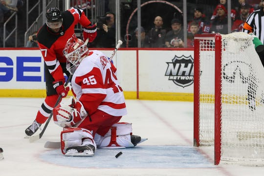 Feb 13, 2020; Newark, New Jersey, USA; Detroit Red Wings goaltender Jonathan Bernier (45) makes a save on New Jersey Devils right wing Wayne Simmonds (17) during the second period at Prudential Center.