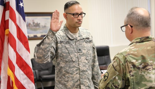 Sgt. Syed Farhaj Hassan is shown at Fort Dix during his reenlistment ceremony, Monday April 16, 2018.  During the ceremony he recites the Oath of Enlistment, which states, among other things, that he will obey the orders of the President of the United States.