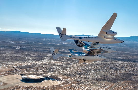 Virgin Galactic's carrier aircraft is seen carrying spacecraft, VSS Unity, for the first time over Spaceport America in Sierra County, New Mexico. Thursday, Feb. 13, 2020.