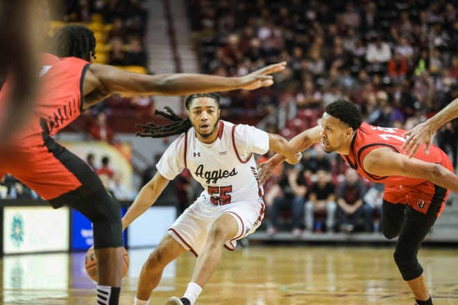 Junior guard Shawn Williams puts the ball on the deck during New Mexico State's game against the Seattle Redhawks at the Pan American Center in Las Cruces on Thursday, Feb. 13, 2020.