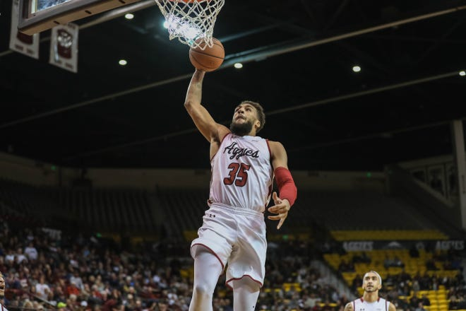 NMSU junior forward Johnny McCants (35) dunks as The New Mexico State Aggies face off against the Seattle Redhawks Pan American Center in Las Cruces on Thursday, Feb. 13, 2020.