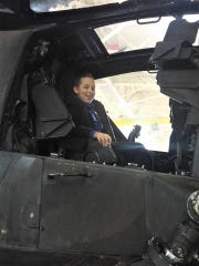 Sebastian Teran seated in a Blackhawk helicopter while in Fairbanks, Alaska, for the memorial service of his brother, Logan, who died while stationed at Ft. Wainwright.