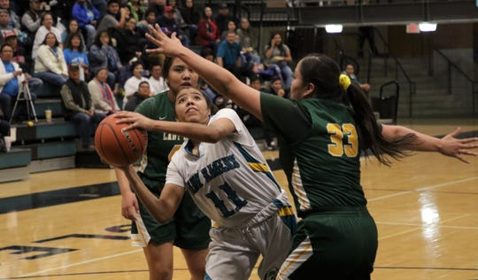 Navajo Prep's Hailey Martin attacks the basket against Thoreau during Thursday's District 1-3A girls basketball game at the Eagles Nest in Farmington.