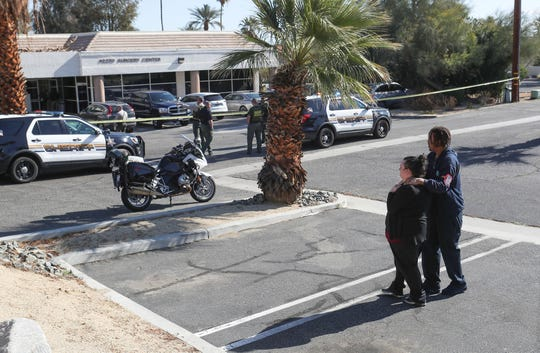 People console one another at the Rancho Mirage medical office where a shooting took place the morning of February 14, 2020.