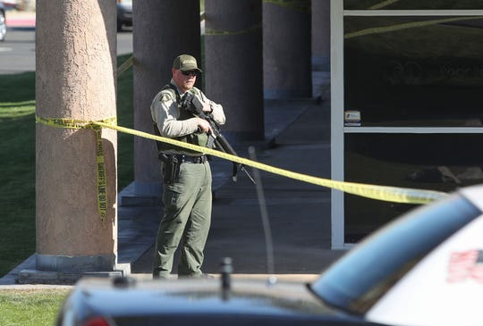 An armed Riverside County sheriff's deputy stands guard outside a Rancho Mirage medical office Friday, Feb. 14, 2020. Two men were killed in a murder-suicide and officials identified the victim as a local surgeon. His relationship with the suspect is under investigation.