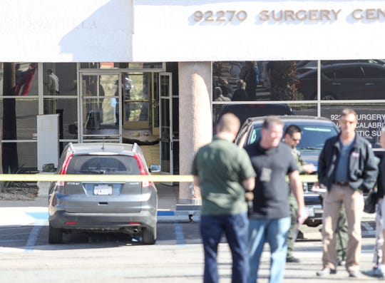 A body can be seen laying in the hallway at the Rancho Mirage medical office where a shooting took place the morning of February 14, 2020.