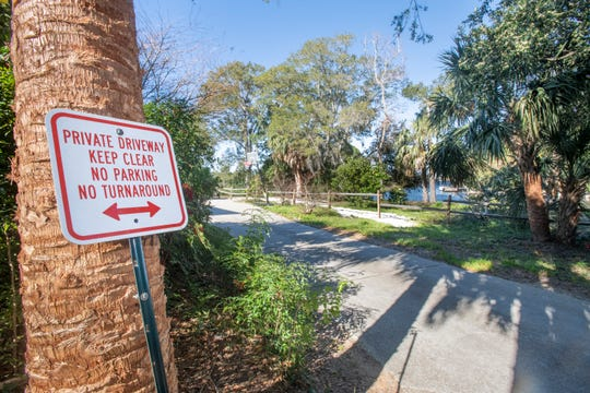 The end of Navy Cove Boulevard in Gulf Breeze is pictured Friday. A Santa Rosa County judge will decide the fate of public access to the water and a path to Deadman's Island at the end of the road.