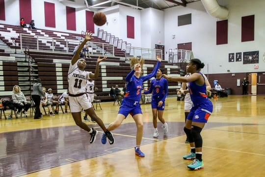 PHS' Nala Baker (11) makes a jumping shot against Jacksonville Bolles in the first round game of the state playoffs on Thursday, February 13, 2020, at Pensacola High School. The Tigers won 56-43 and move on to the next round.
