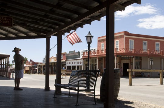 Charles Smith, left, of Hampton, Virginia looks out toward the two-story Crystal Palace Saloon on Allen Street in Tombstone, Arizona. He said he visited the site of his great, great, great-uncle, who is buried in Boothill Graveyard. Tombstone became known as the Town Too Tough to Die.