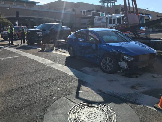 A crash between two vehicles near Camelback Road and Goldwater Boulevard in Scottsdale on Feb. 14, 2020 left three people injured, including a pedestrian.