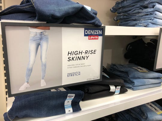 Holding up a pair of these high-waisted jeans didn't look like typical mom jeans. I'd seen them lately in fashion magazines and on social media. Stacks of them in Target confirmed they were back in style.