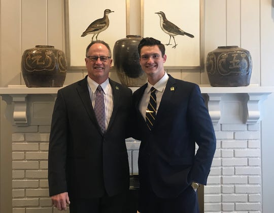 Steve and Christian Kreamer. The father-son duo are the third and fourth generation to work the family funeral home business.