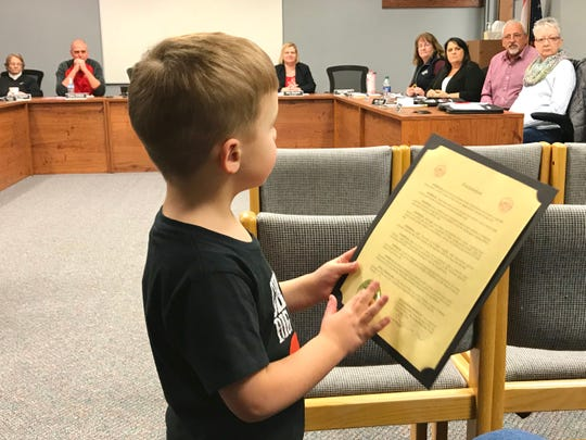 Lucas Gutman, 4, holds an official proclamation in honor of him from the City of Port Clinton. Gutman was diagnosed with hypoplastic left heart syndrome as an infant, but he does not let that slow him down.