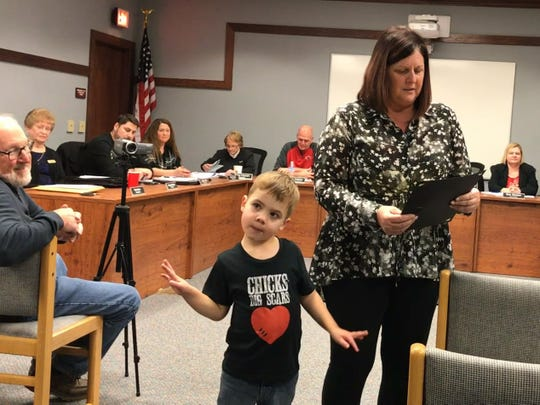 "Lucas Gutman, 4, listens along as Port Clinton City Council President Lisa Sarty reads an official proclamation from the city recognizing ""Conquering Congenital Heart Defect Week."""